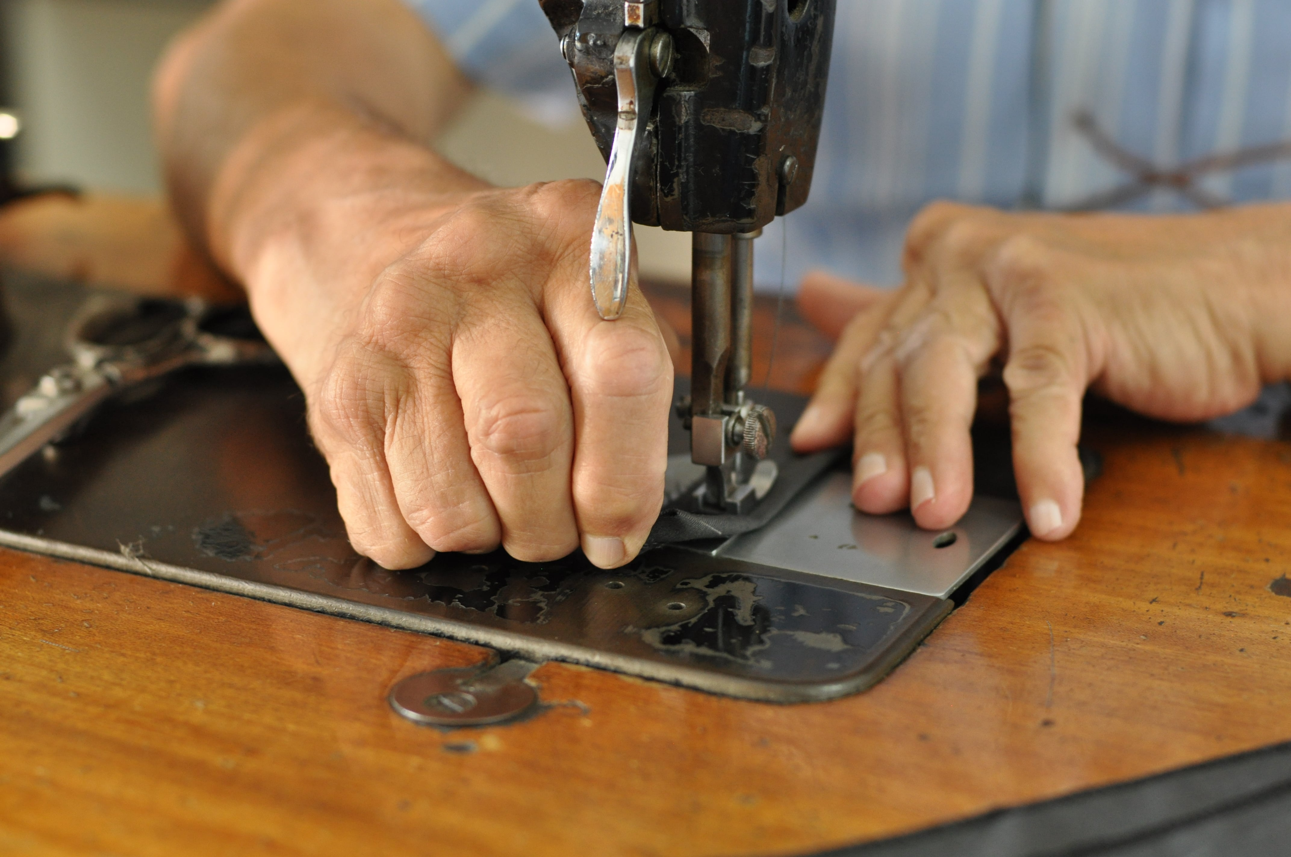 hands working at a sewing machine